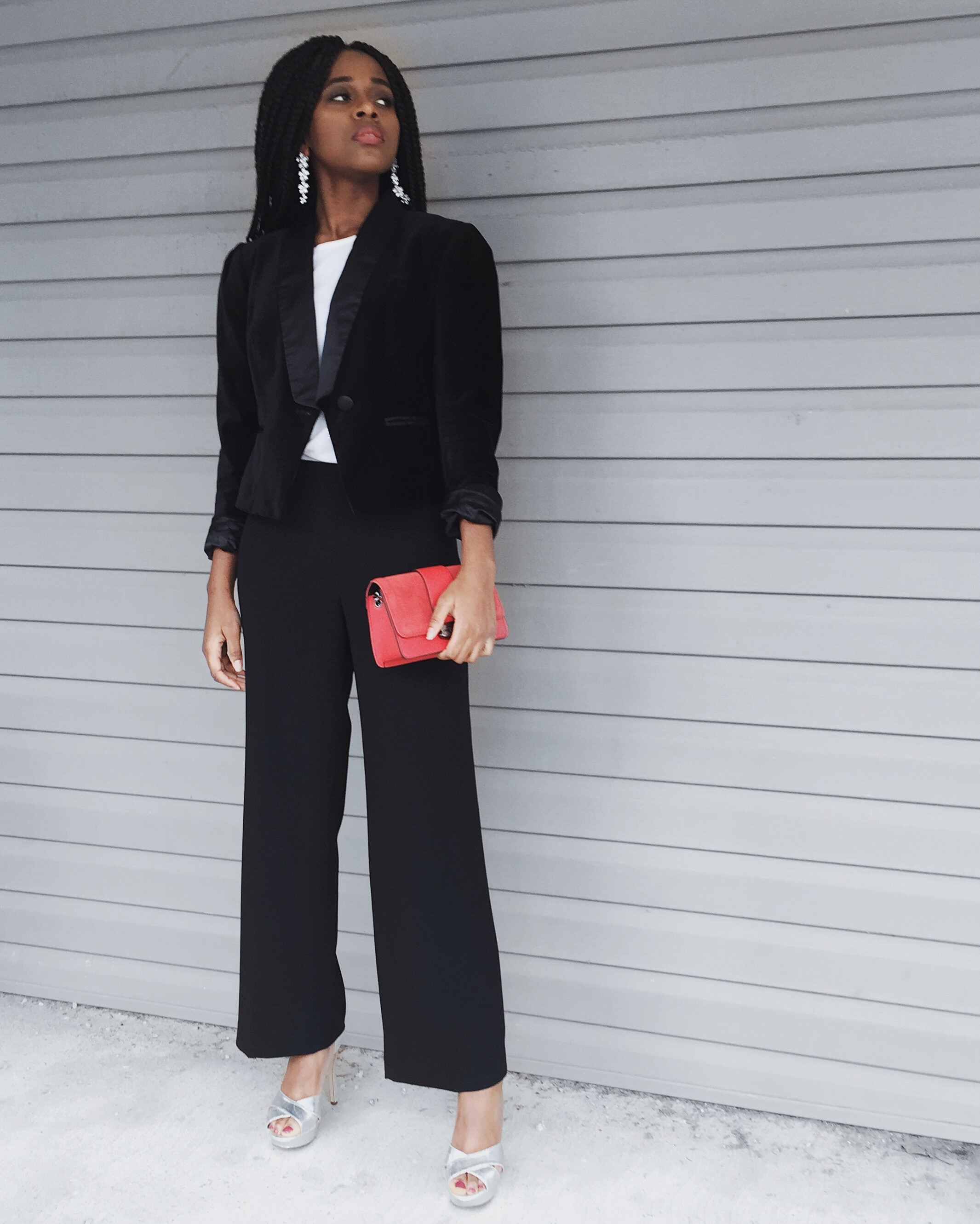 white t-shirt, black blazer, black dress pants, silver heels, red purse