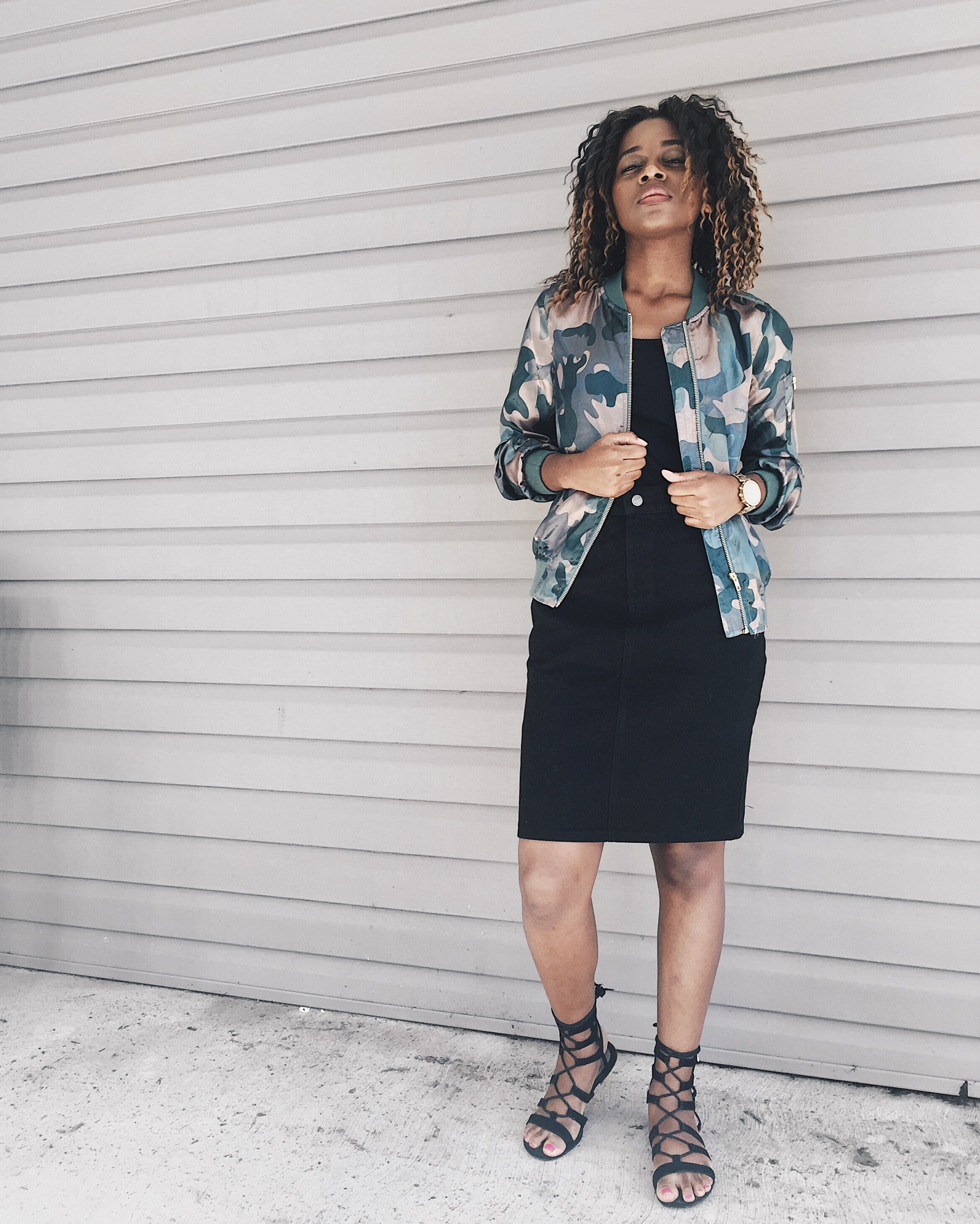 camouflage silk bomber jacket, black tank top, black denim skirt, black lace up sandals