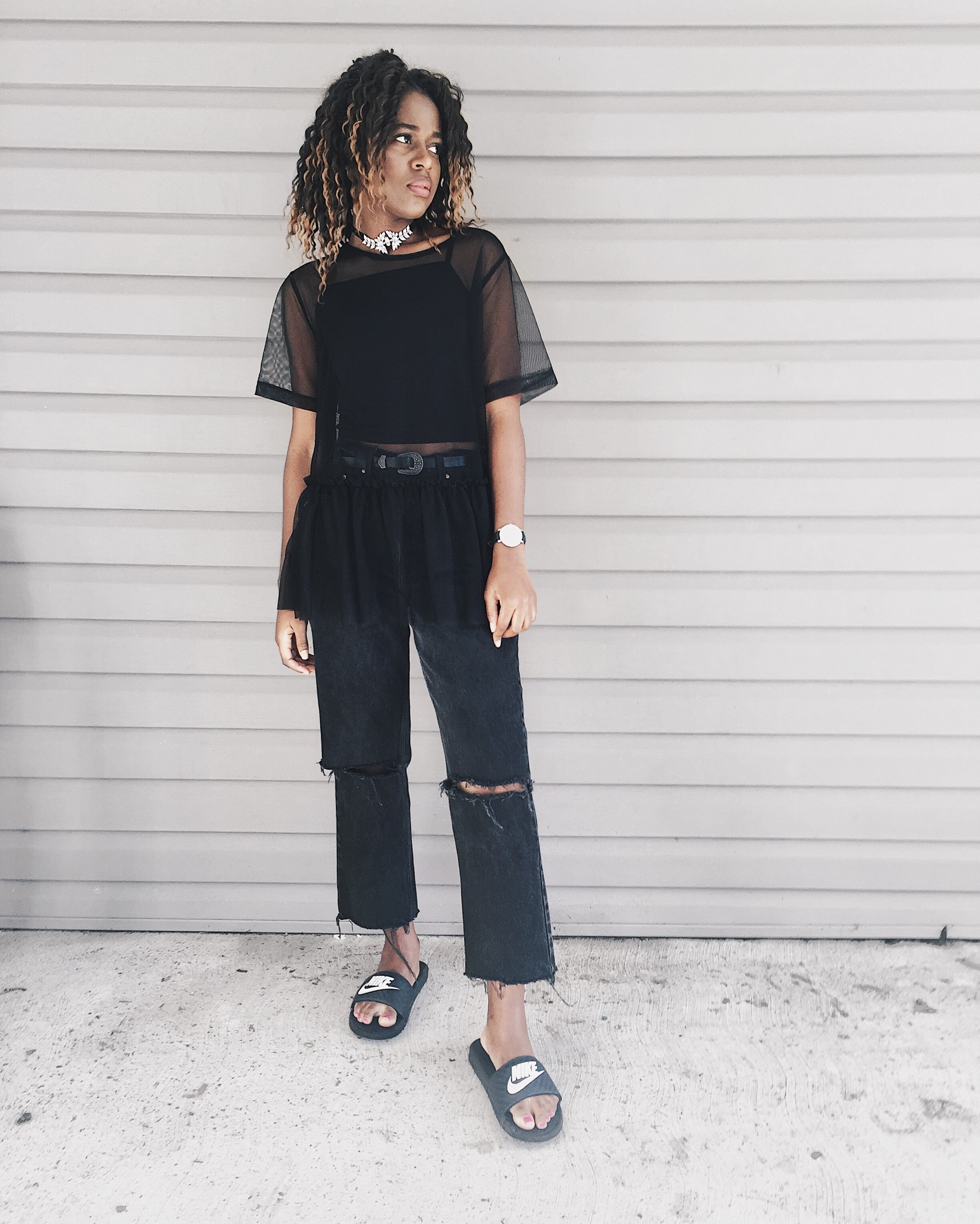black destroyed denim jeans, mesh top, black tank top, nike slides, diamond choker