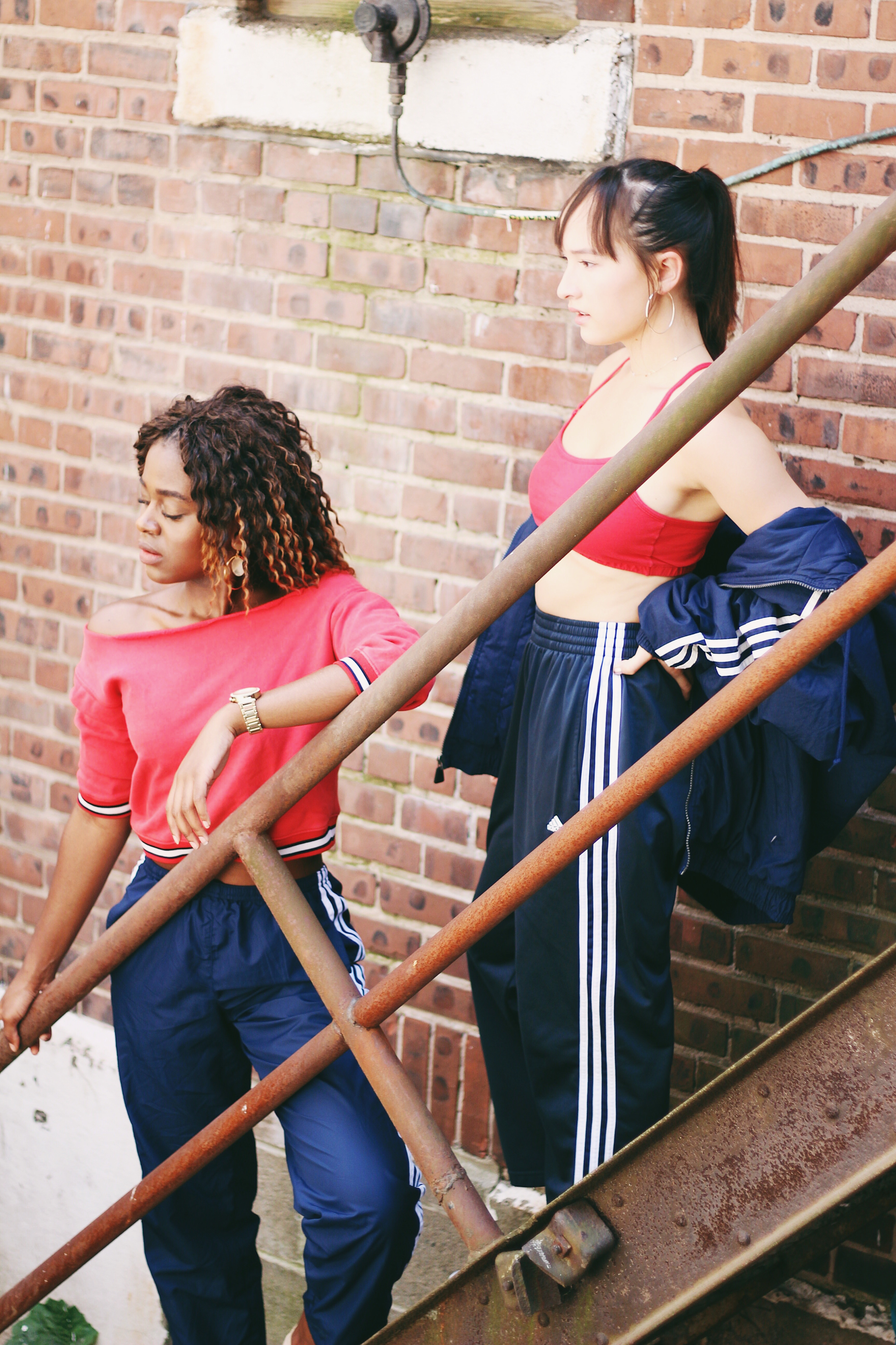 adidas jacket, adidas sweatpants, Tommy Hilfiger shoes, red sports bra, silver hoop earrings, thrift store outfit