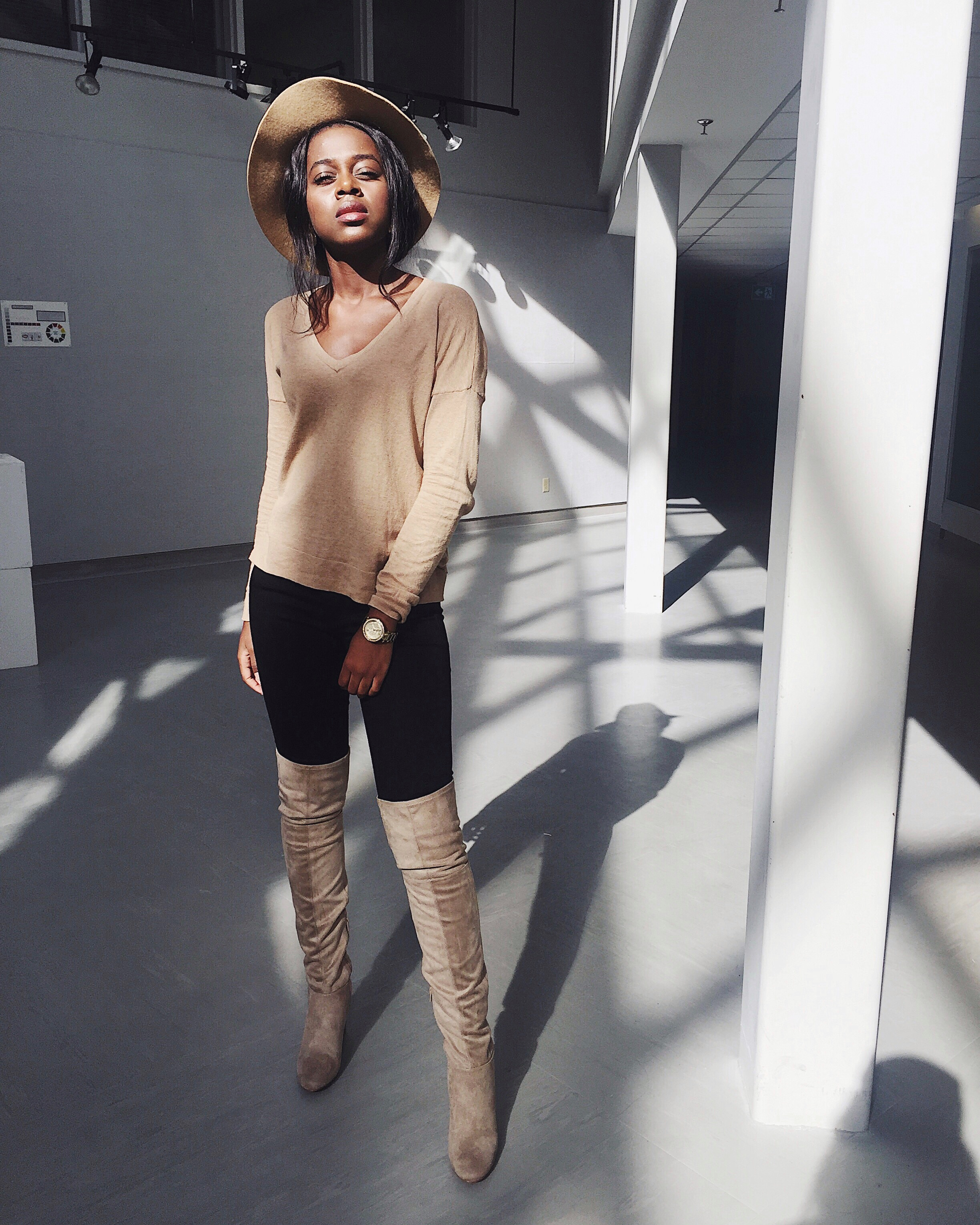 H&M black jeans, Camel Gap long sleeve top, Gold Michael Kors watch, camel thigh high boots H&M, camel fedora hat Call it Spring